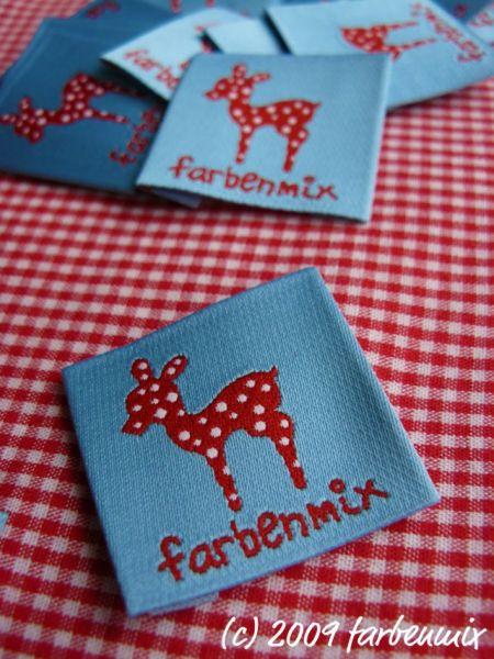 Farbenmix-Etikett mit Reh, hellblau-rot